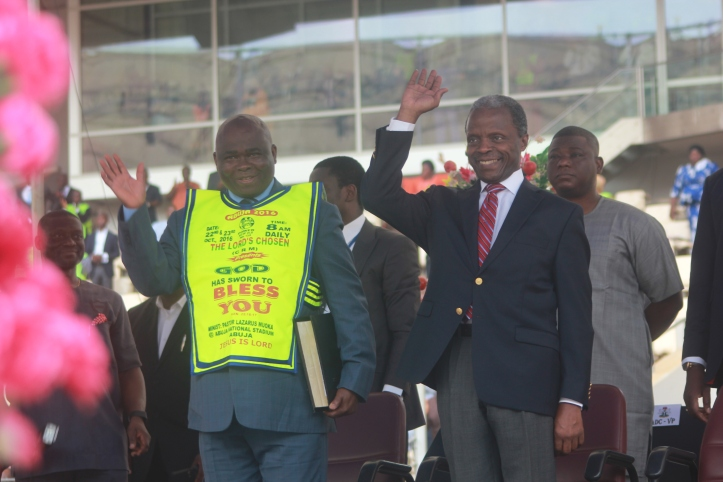 L-R The Vice President, Federal Republic of Nigeria, Professor Yemi Osinbajo with The General Overseer, The Lord's Chosen Charismatic Revival Ministries, Pastor Lazarus Muoka waving to the participants from the pulpit during the Abuja 2016 International Programme titled 'God has sworn to Bless You