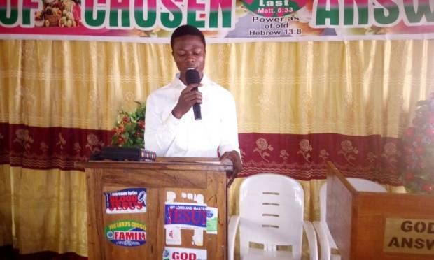 """Moderator now on the pulpit as the congregation sing the welcoming song """" chosen campus fellowship..."""""""