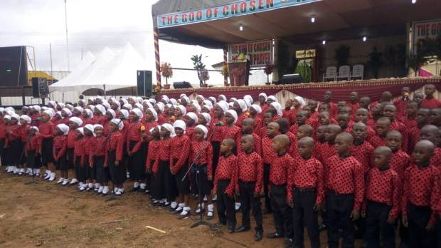 """The children choir ministering to the congregation """"Heaven is a place I want to be"""""""